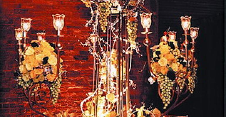 A Legendary Event Atlanta starts a threeyear Gala winning streak in 2002 with its La Dolce Vita design featuring gold and silver table linen candelbra and square silver dishes The dramatic centerpiecewith clusters of grapes lemons limes pears roses miniature callas and golden yarrowwas lit from beneath