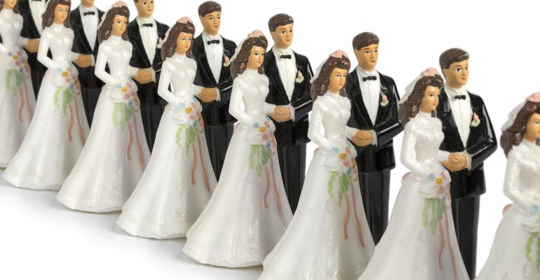 Row of vintage bride and groom figurines