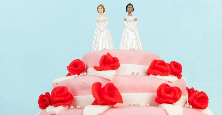 two brides on wedding cake