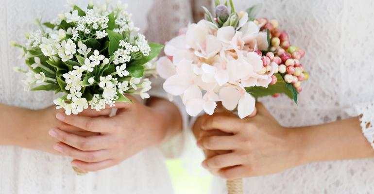 two brides with bouquets