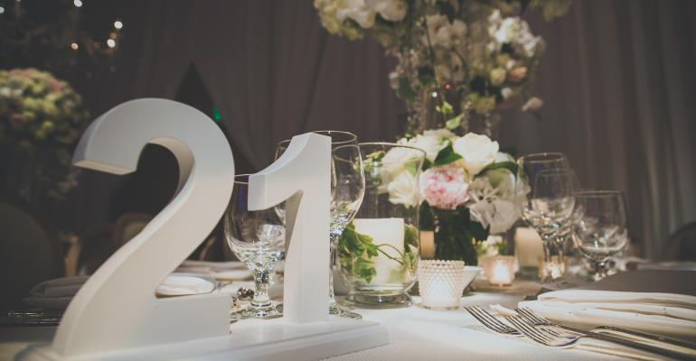 Oversize table numbers at ballroom wedding reception