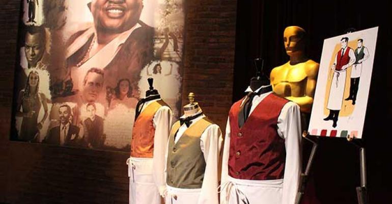 An image of Academy Award winner Hattie McDaniel looks over the Oscar waiter uni