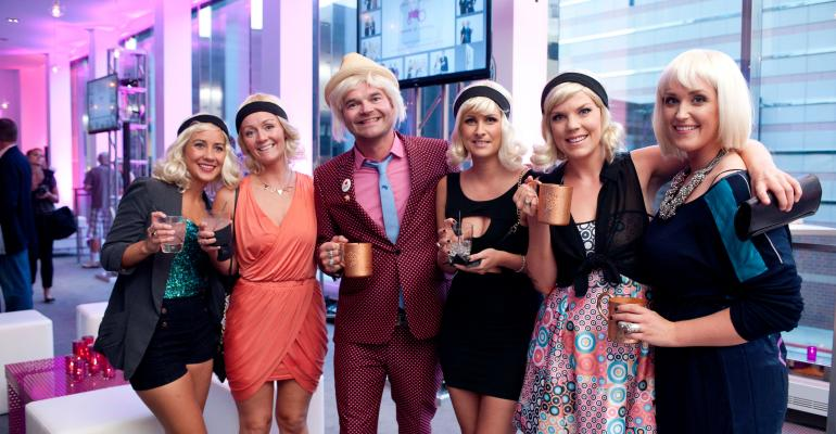 Moods of Norway cofounder Simen Staalnacke center poses with some fairhaired friends at Sheba Productions39 Moods of Norway launch party in Minneapolis Photo by Bruce Silcox
