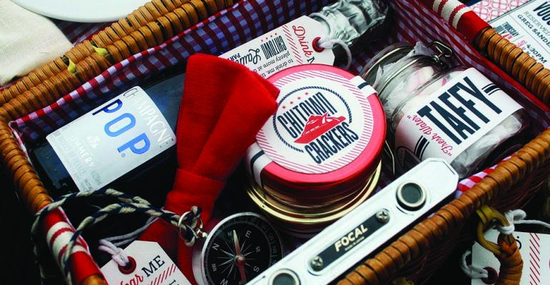 From Lindsey Luxa an invitation for a yacht launch party yacht launch party that included a picnic on the docks The mini picnic basket includes edibles a personalized engraved compass and other nautical elements such as signal flags quotI love creating invitations that promote guest interaction and defy the expectations of what an invitation should andor could bequot Luxa says