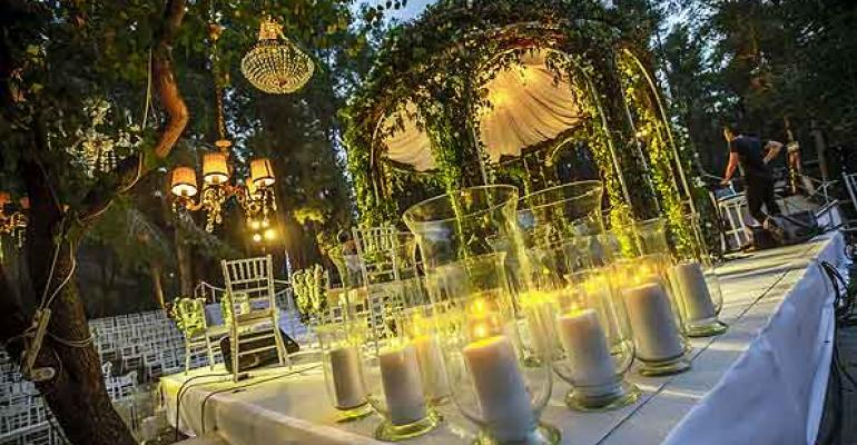 The KBY Designs team transforms Neot Kedumima Biblical landscape reserveinto three stunning settings for an unforgettable outdoor wedding featuring a 1000bulb custom chandelier Photos by Ronen Boidek and Benny Gamzo