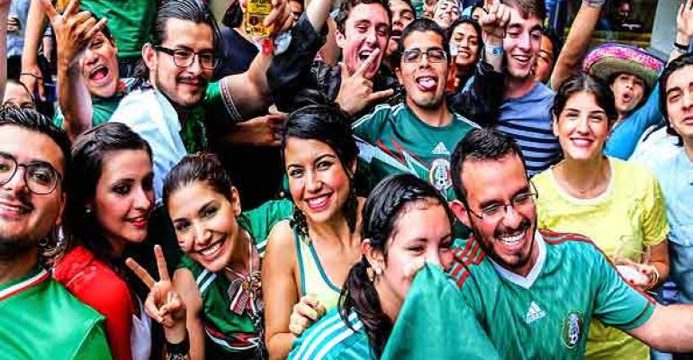 Soccer fans celebrate a win