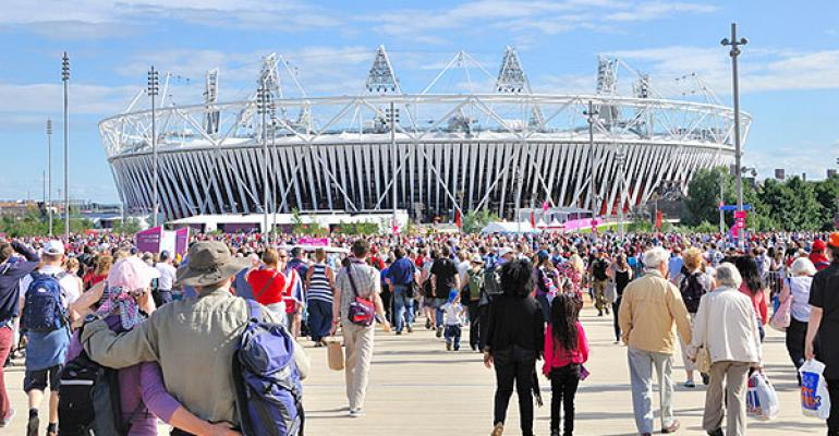 Guests stream into the Olympic Stadium in London