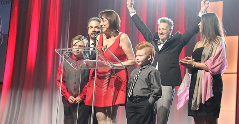 The teams from Extraordinary Events and Brite Ideas accept their Gala Award at T