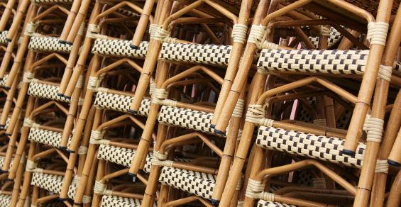 stacks of rattan chairs