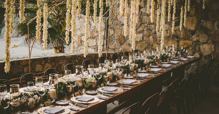 dining table with floral chandelier