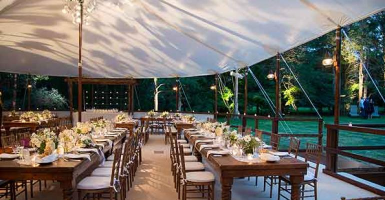 A beautiful wedding from Stamford Tent and Event Services featuring farm tables